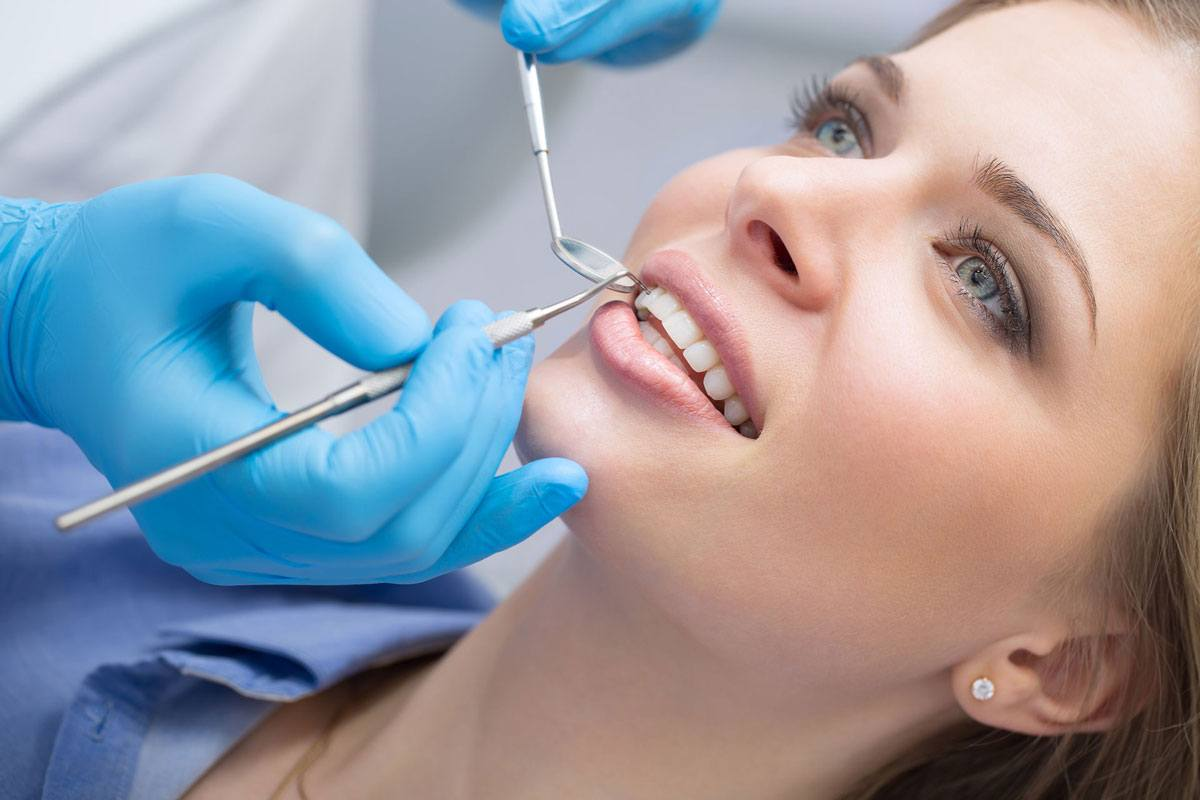 Woman getting a dental exam